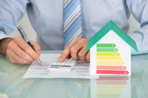 51924965 Close Up Of Businessman Calculating Energy Efficiency Rate Of House In Office 123rf.jpg