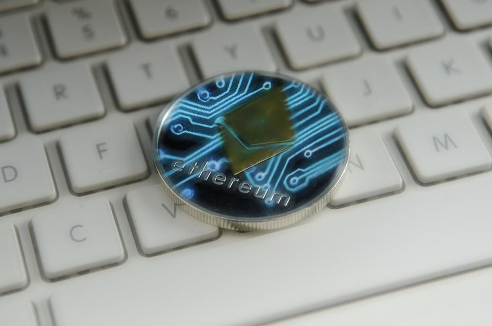 A physical representation of ether, a digital currency, on a keyboard.