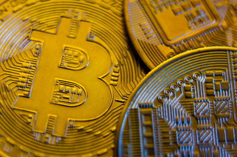 A physical unit of bitcoin, a digital currency.